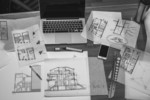 Image of a pc notebook and architectural drawings